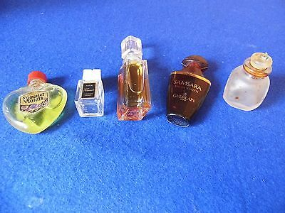 5 miniature perfume bottles