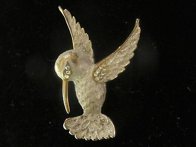 "Hummingbird brooch , frosted look, rhinestones, copper back. 2 1/4""  X 1  1/2"""