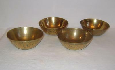 Four Antique Chinese Brass Bowls Engraved with patterns - or clock bells....