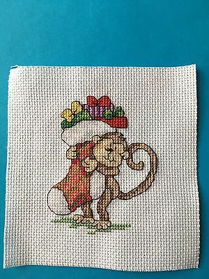 Completed Cross Stitch - Monkey carrying Christmas Stocking