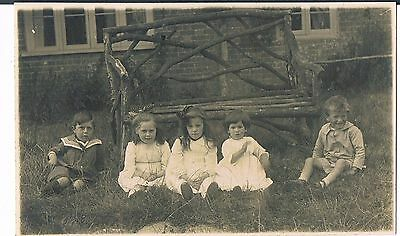 Private Portrait Postcard Of Five Children Sitting By An Old Rickety Bench C1910