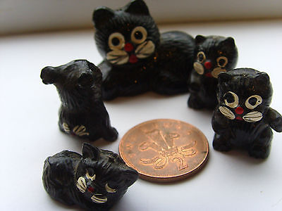 Vintage Miniature black cat family made in hard plastic