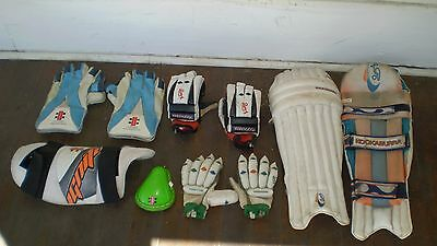 Mixed selection of Cricket gear, pads, gloves. Youth size