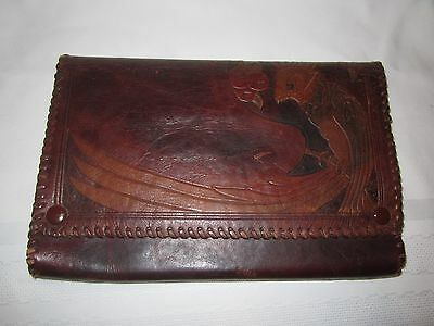 Vintage brown leather clutch bag with embossed parrot design