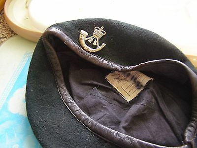 dark green beret with badge about size 58 ish
