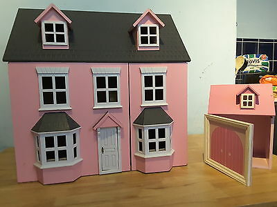 Pink and white dolls house with garage no furniture