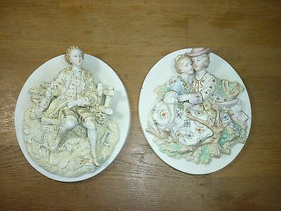 Pair of Ceramic or Pottery High Relief Wall Plaques