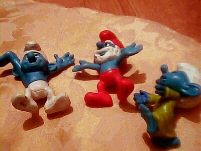 Collectable Smurfs three figures each with thier name signature on the feet 3in