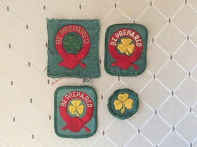 Girl Scout First Class Award patches (3 different) and the yellow trefoil patch