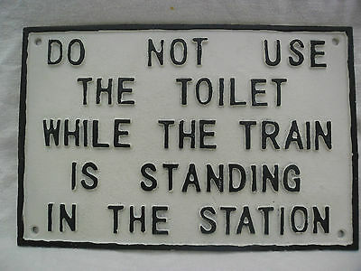 'DO NOT USE THE TOILET WHILE TRAIN IN THE STATION'  ~CAST IRON WALL SIGN. New.