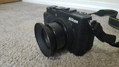 Nikon COOLPIX P7700 camera with hood, cap, and 16 GB SD card