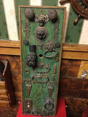 Board with Antique Hardware Display Lion Heads, etc.