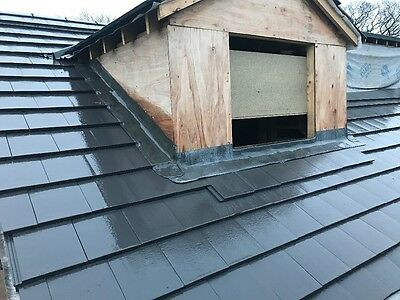 Approx 1200 smooth grey lagan roof tiles