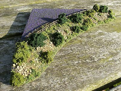 N gauge model railway layout scenery corner field with fencing and purple crop