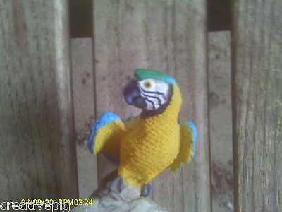 Bright Blue & Dark Yellow Parrot Perched on Rocks Figurine