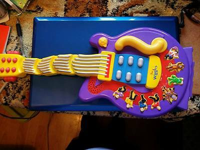 """Wiggles guitar 18"""" long.... In working order....Please look at description....."""