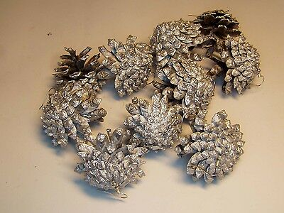 10 pine cones painted in silver with hooks for Christmas tree ornaments.