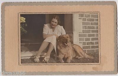 Gorgeous Coloured Photo of a woman with her favorite Pet- Golden Retriever