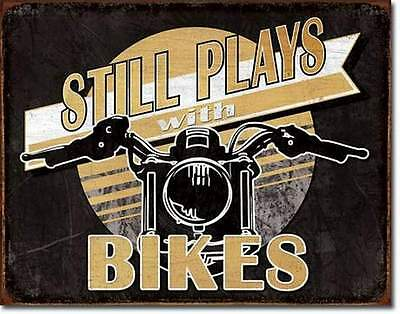 Still Plays With Bikes - Rustic Tin Metal Sign