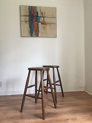 A Pair Of Vintage Ercol Lab Stools