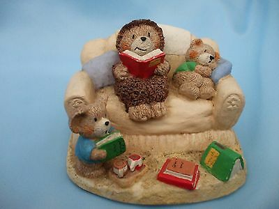 Collectable Teddy Bears and Hedgehog Ornament on a Settee