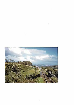 A colour postcard of Ballindrait Railway Station on The County Donegal Ry .