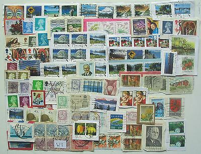 World Used Lot 100 stamps on paper.
