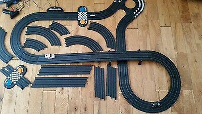 My First / Micro Scalextric track layout with exra track as well!