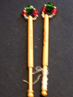 Pair of spangled wooden lace bobbins  Christmas 1992