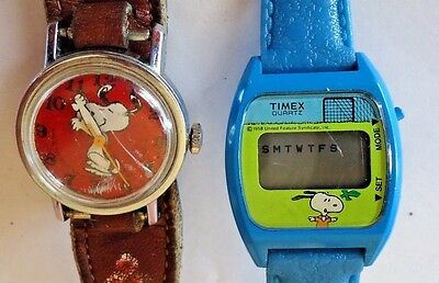Lot of 2 vintage Snoopy watches 1 digital by Timex one wind up moving arms