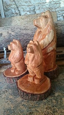 Chainsaw carved three bears