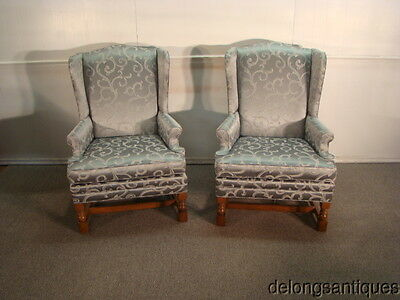 42938 Pair of Oak Framed Wing Back Chairs