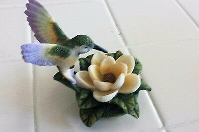 Porcelain Bisque Hummingbird With Yellow Flower