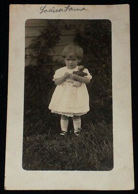 Vintage 1910 Real Photo Post Card of Little Girl w/ Doll in Backyard