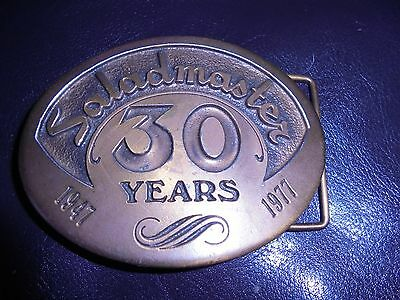 collectible belt buckle-Saladmaster-30 years (1947-1977)-neat item