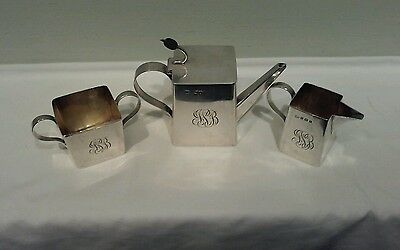 A Hukin, Heath, Middleton, and Christopher Dresser Sterling Silver Tea Set