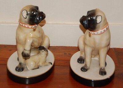 Pair of Vintage Antique Style Pugs with Cropped Ears and a Puppy