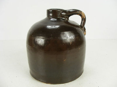 Old brown crock jug maybe made by Minnesota Stoneware