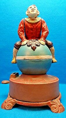 Spinning Acrobatic Clown on Globe (ball) Cast iron Mechanical Bank Reproduction