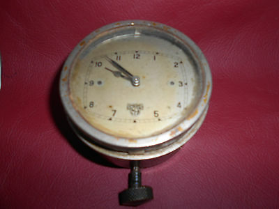 Smiths vintage car clock , silver face, bottom winder, early 1930s