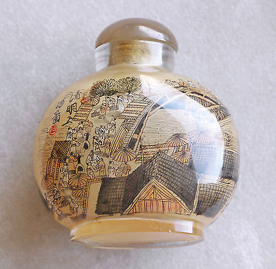 Antique large reverse-painted snuff bottle. Elaborate market scenes both sides