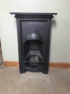 Reclaimed antique cast iron fireplace with mantle.