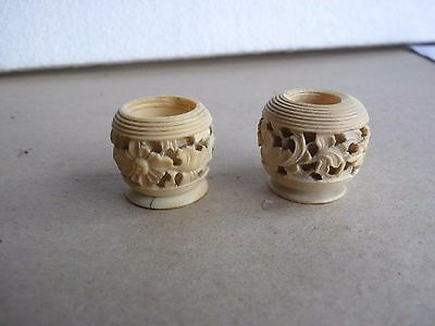 vintage small carved pots made of white material , two of