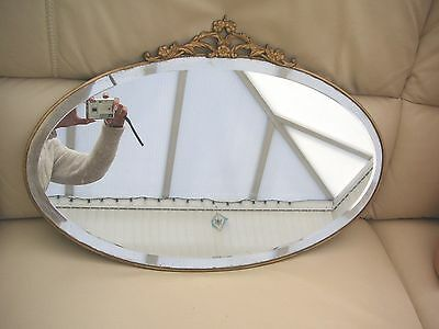 VINTAGE OVAL WALL MIRROR, METAL SURROUND, EARLY 20th CENTURY.