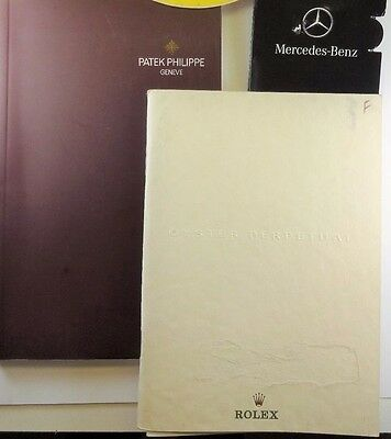 Set Of Patek Philippe And Rolex Catalogues And Merced Benz Lepel Pin