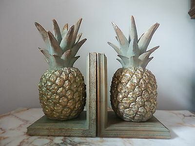 A Pair Of Golden Pineapple Fruit With A Soft Grey/Green Wash Bookends
