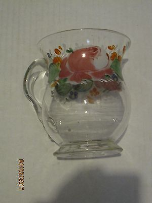 Handpainted blown glass pitcher with applied handle.
