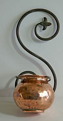 Vintage small hammered copper bowl with S shaped wrought iron wall hanger