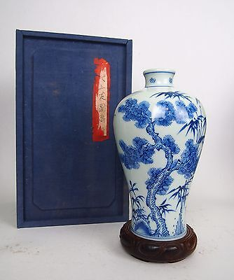 A Blue and White 'Three Friends of Winter' Meiping Vase, Wooden Stand and Box