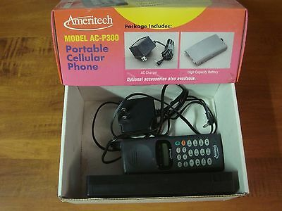 Vintage mint boxed Ameritech cell phone, VCR tape, phone charger